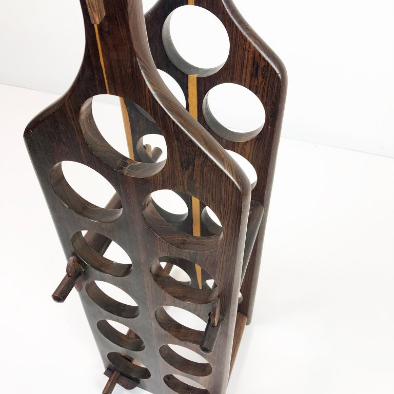 This amazing wine rack are made of cocobolo wood, attributed to Don Shoemaker, circa 1960. The rack holds eleven wine bottles and can be completely disassembled, excellent vintage condition.