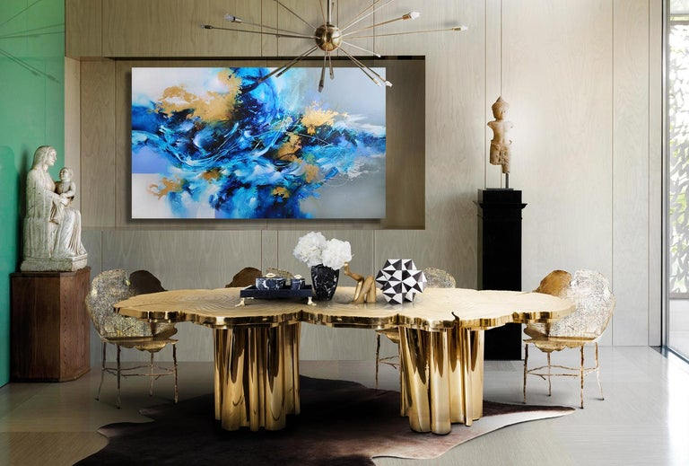 Talk about a statement piece!! Contemporary and abstract expressionist in style, this vibrant blue & gold original work of art is rich in color & texture and has a great illusion of depth masterfully created by the artist. It includes gold leaf