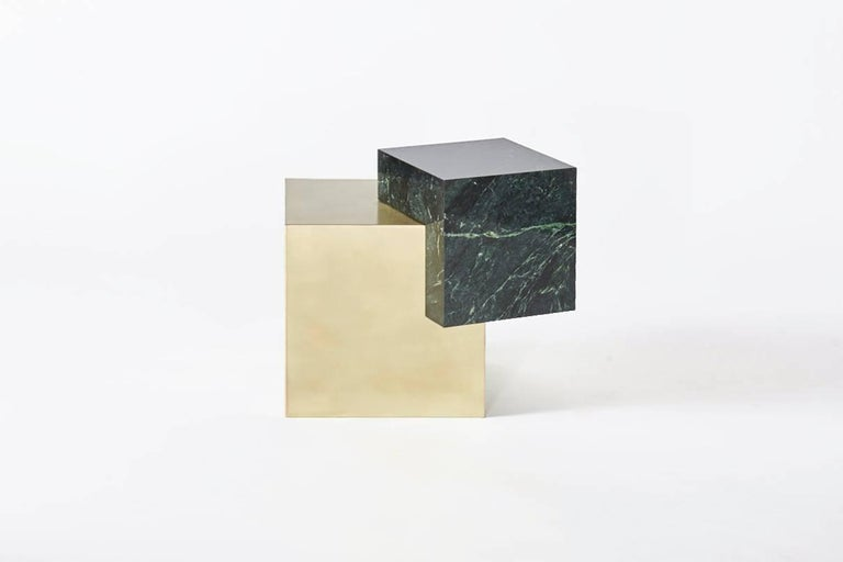 You can now give your room a sophisticated appeal, with this Coexist Askew furniture. This side table is made from Empress Green marble cube and brushed brass cube.It has a state-of-art design, which enhances the ambiance in any room. Besides its