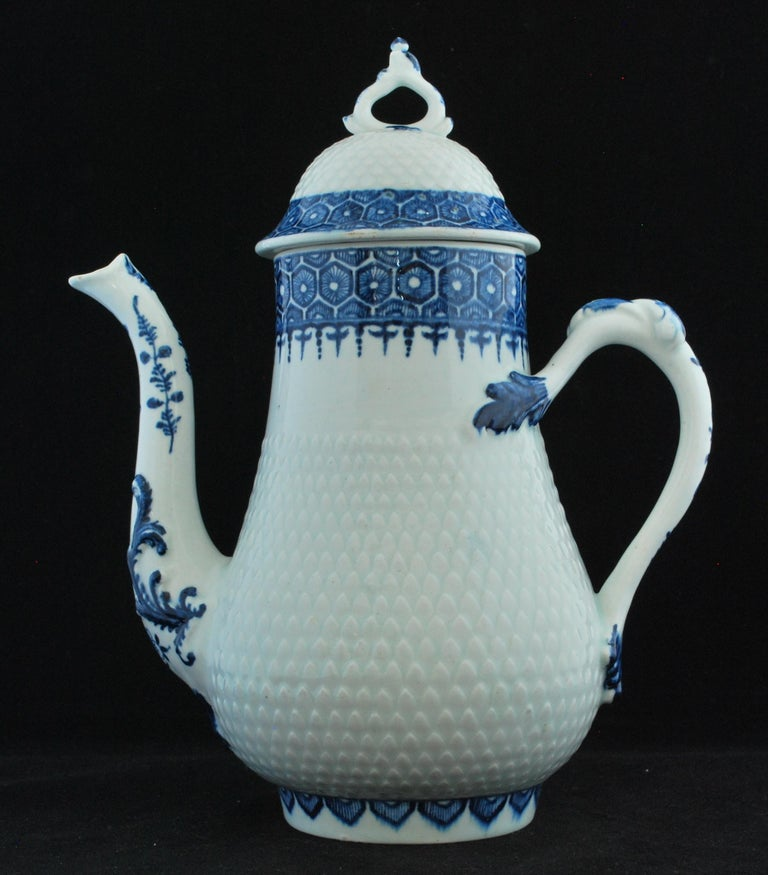 Coffee pot, circa 1765-69: Coffee pot and cover of silver form with domed cover; the body of the pot and dome of the cover pineapple moulded between rims painted in blue with cell and diaper borders; the spout of curving swan-mouth form moulded with