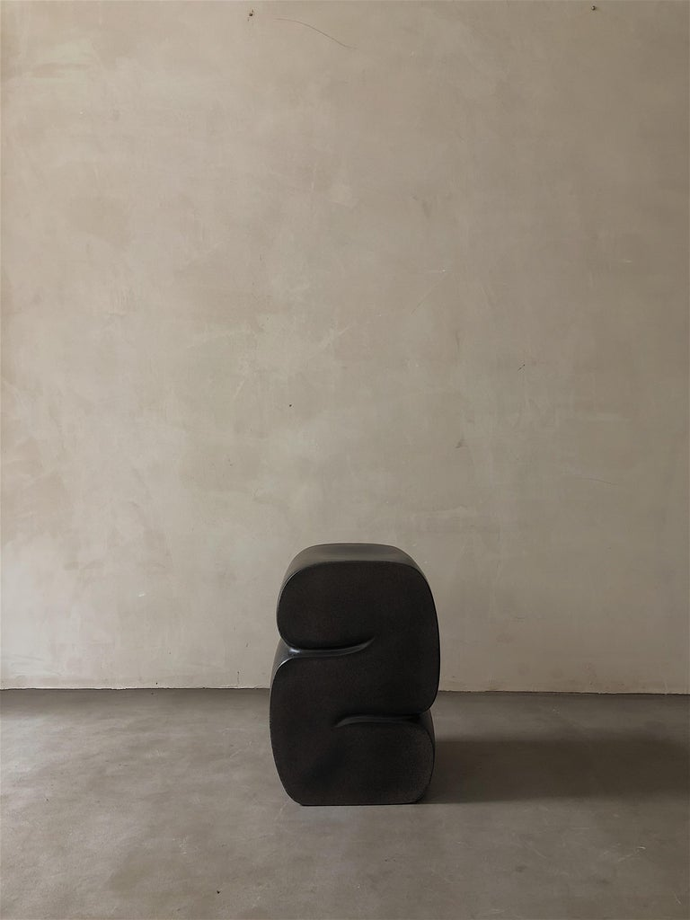 Coffee stool by Karstudio Materials: FRP Dimensions: 32 x 32 x 45 cm  It shapes in a curl-up position, casual meanwhile restrained. The side designed as a cross-section of the furniture to present the curve and texture.  Kar- is the root of
