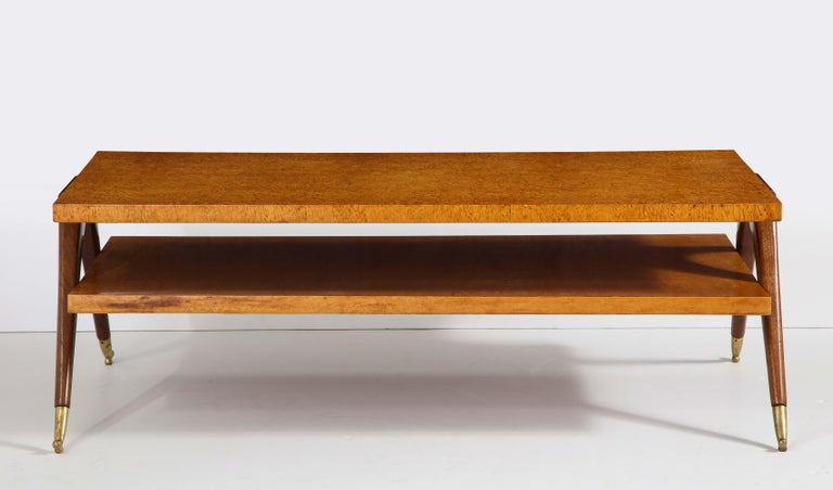Two-tiered burl wood and mahogany coffee table with brass sabots.
