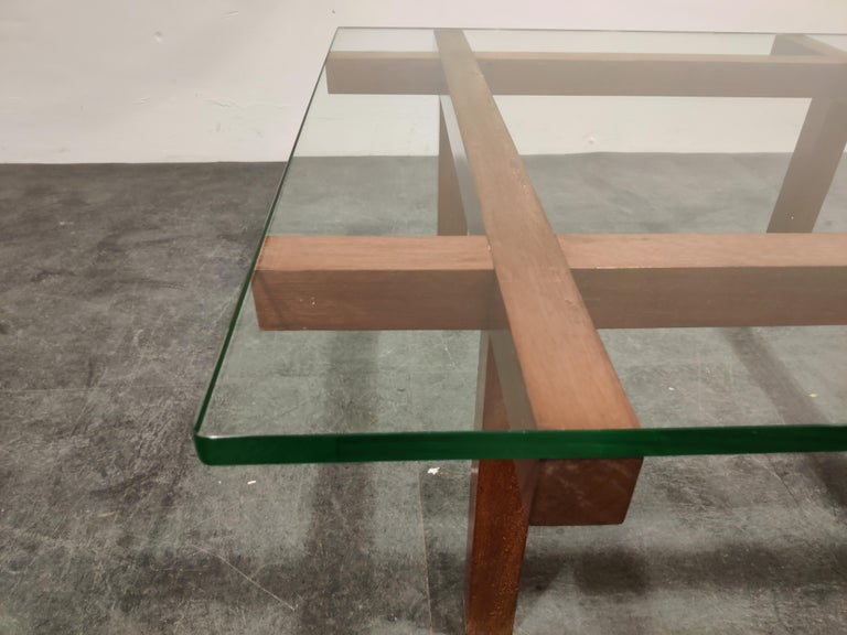Minimalist coffee table by the Belgian designer Alfred Hendrickx for Belfom.  Made from a geometric teak base and a thick glass top.  One of our favorite (belgian) designers of the midcentury era.  Good condition.  1960s -
