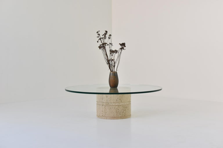 Lovely coffee table by Angelo Mangiarotti for Up & Up, Italy, 1970s. This table features a glass round top that rests on a unique cylinder shaped pedestal base. The table is in a beautiful and original condition (some normal scratches from age and