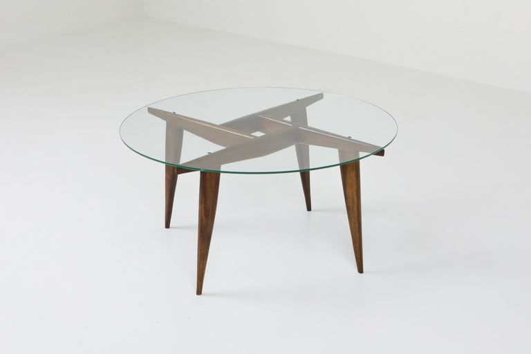 Mid-century modern rare and singularly elegant coffee table by Gio Ponti for Singer & Sons, Italy, early 1950s. Solid walnut base with glass top.