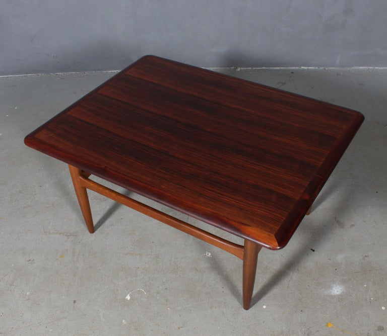Kurt Østervig coffee table with rosewood plate.  Legs in stained beech.  Model 195. Made by Jason Møbler in the 1960s, Denmark.