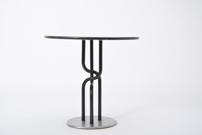 Danish Post-Modern side table by Rud Thygesen and Johnny Sorensen for Botium - Round coffee table designed by Rud Thygesen and Johnny Sørensen - Produced by Botium in Denmark in 1989 - The table has a white laminate tabletop - Black lacquered steel