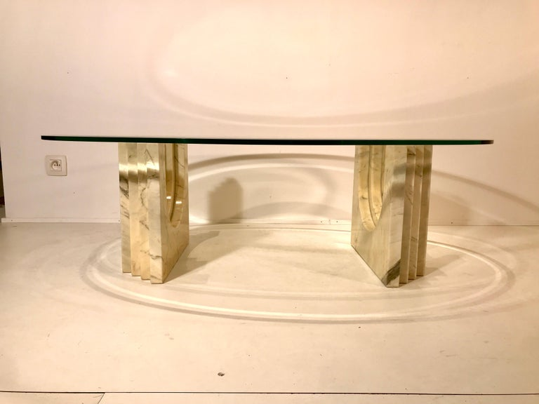 Very rare coffee table in Carrara marble probably by Tobia Scarpa , with oval top glass, Italy circa 1970 in perfect and original conditions. Two different way to place the base. Dimensions: with top glass 120 x 80 x 36cm.  the marble base 42 x