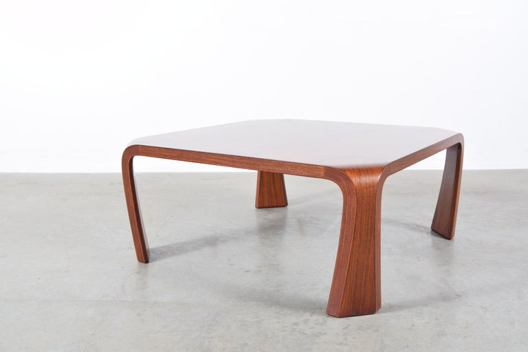 Coffee table designed by Saburo Inui for Tendo Mokko, Japan, circa 1960. Table is constructed of laminated rosewood and Japanese elm plywood. This design is based on the traditional Japanese Chabudai. Table measures 29 3/4