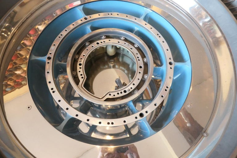 This coffee table is made from a booster stage of a CFM56 reactor. Legendary turbojet engine, more than 26,000 units built for the Airbus A320, B737 and DC-8, among others. Presented in a polished mirror finish with blue color in the center. This
