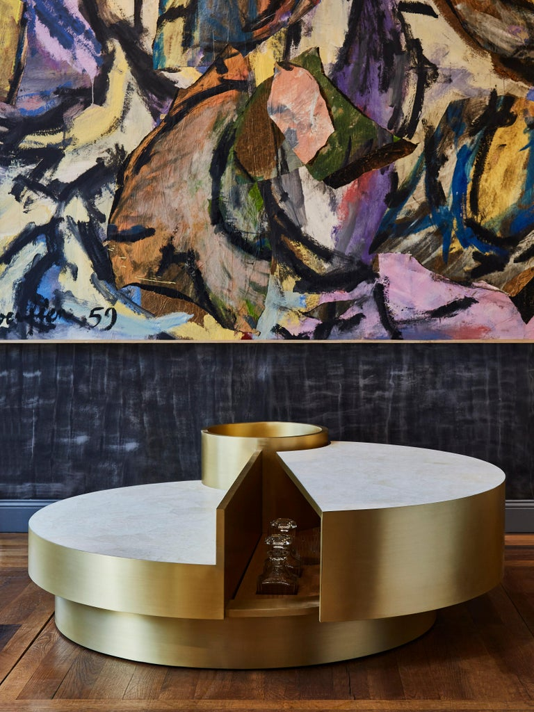 Stunning coffee table in the spirit of Mario Sabot. Top made of rock crystal marquetry and brushed brass.  Can be open to discover a wooden interior with slots for glasses and / or bottles.  Creation by Studio Glustin.