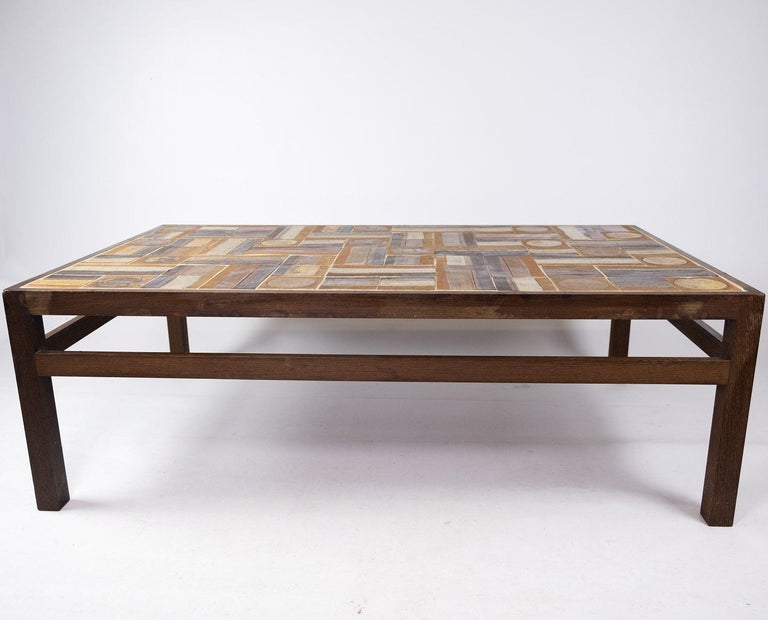 Coffee table in rosewood and dark tiles, designed by Tue Poulsen from the 1970s. The table is in great vintage condition. Measures: H 45 cm, W 134 cm and D 80 cm.
