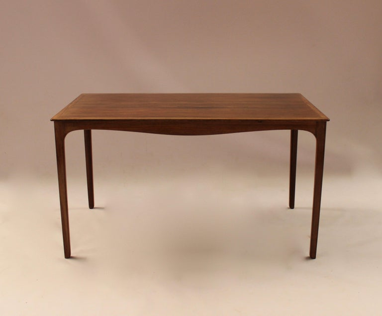 Coffee table in rosewood designed by Ole Wanscher and manufactured by A. J. Iversen in the 1960s. The table is in great vintage condition.