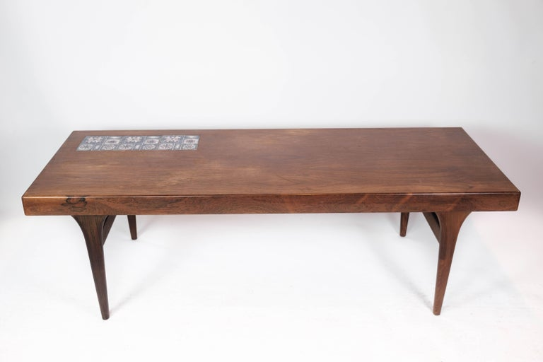 Coffee table in rosewood with blue tiles designed by Johannes Andersen and manufactured by Silkeborg Furniture in the 1960s. The table is in great vintage condition.