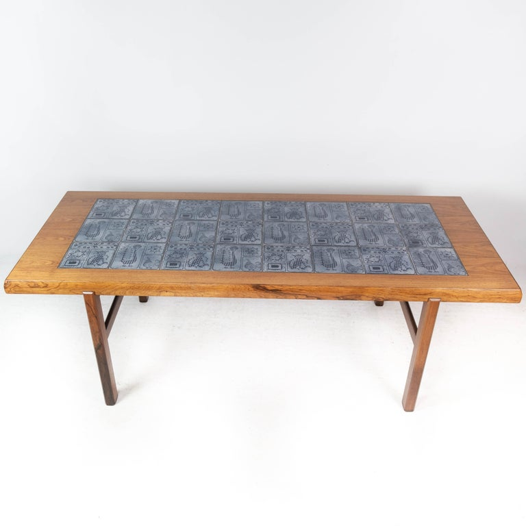 Coffee table in rosewood with blue tiles of Danish design manufactured by Arrebo Furniture in the 1960s. The table is in great vintage condition.