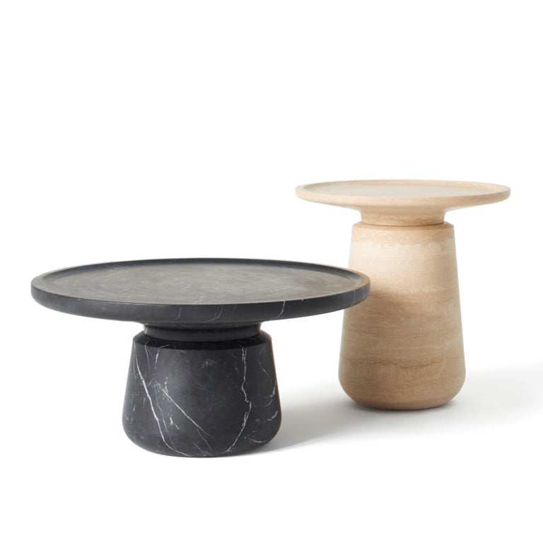 Travertino marble coffee table. Size: 23 (base) x 54 (top diameter) x 54 (height) cm - round top- , 9.1 x 21.2 x 21.2, smooth finishing. Commercial name: Altana Medium by the Spanish Designer Ivan Colominas.  No borders Like the turret-like rooftop