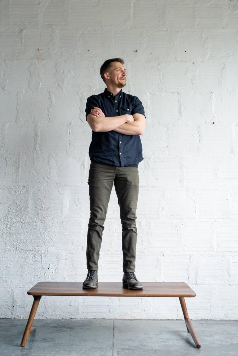 A beautiful, minimal coffee or cocktail table for your home in the Mid-Century Modern or Danish style, with hints of Scandinavian. Handmade from Walnut Hardwood. The legs give this piece a light, airy feel, while strong joinery keeps it stable and