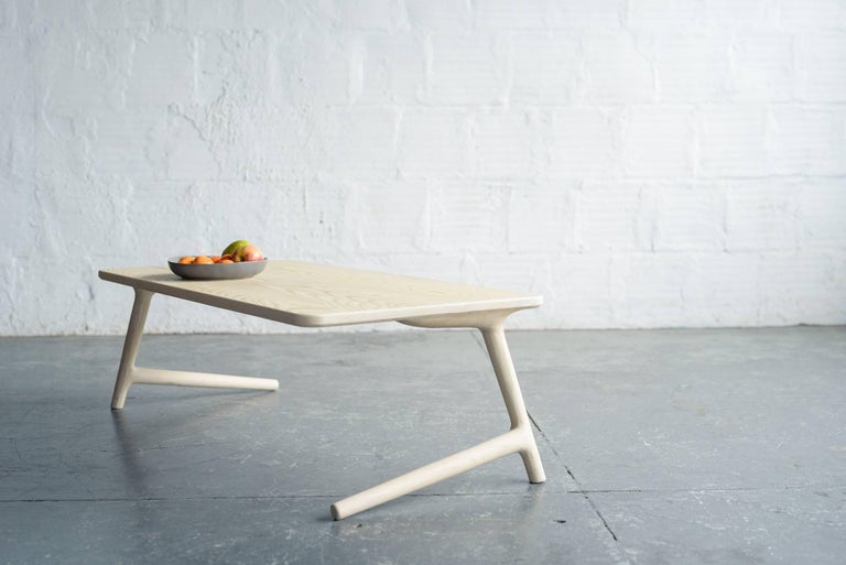 A beautiful, minimal coffee or cocktail table for your home in the Mid-Century Modern or Danish style. Handmade from White Ash wood. The legs give this piece a light, airy feel, while strong joinery keeps it stable and sturdy. (See the second photo