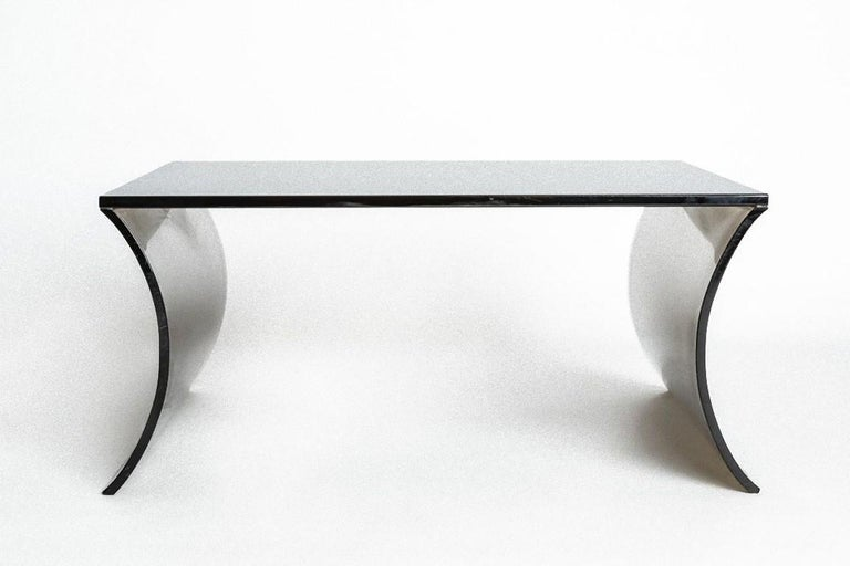 Coffee table is a piece of original design furniture realized in the 1970s by Italian Manufacture.  Elegant coffee table in black curved crystal.
