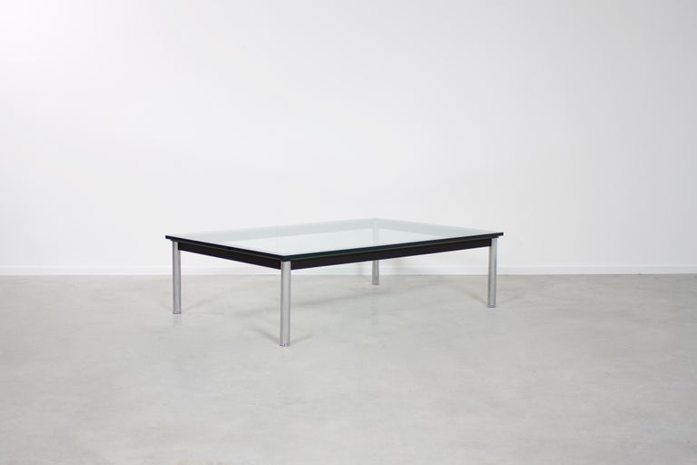 Beautiful LC10 coffee table in very good condition.  Designed by Le Corbusier in 1924  Manufactured by Cassina   The table has a thick glass top which rests on a mat black frame with chromed feet.  The table is signed and numbered.  We offer a