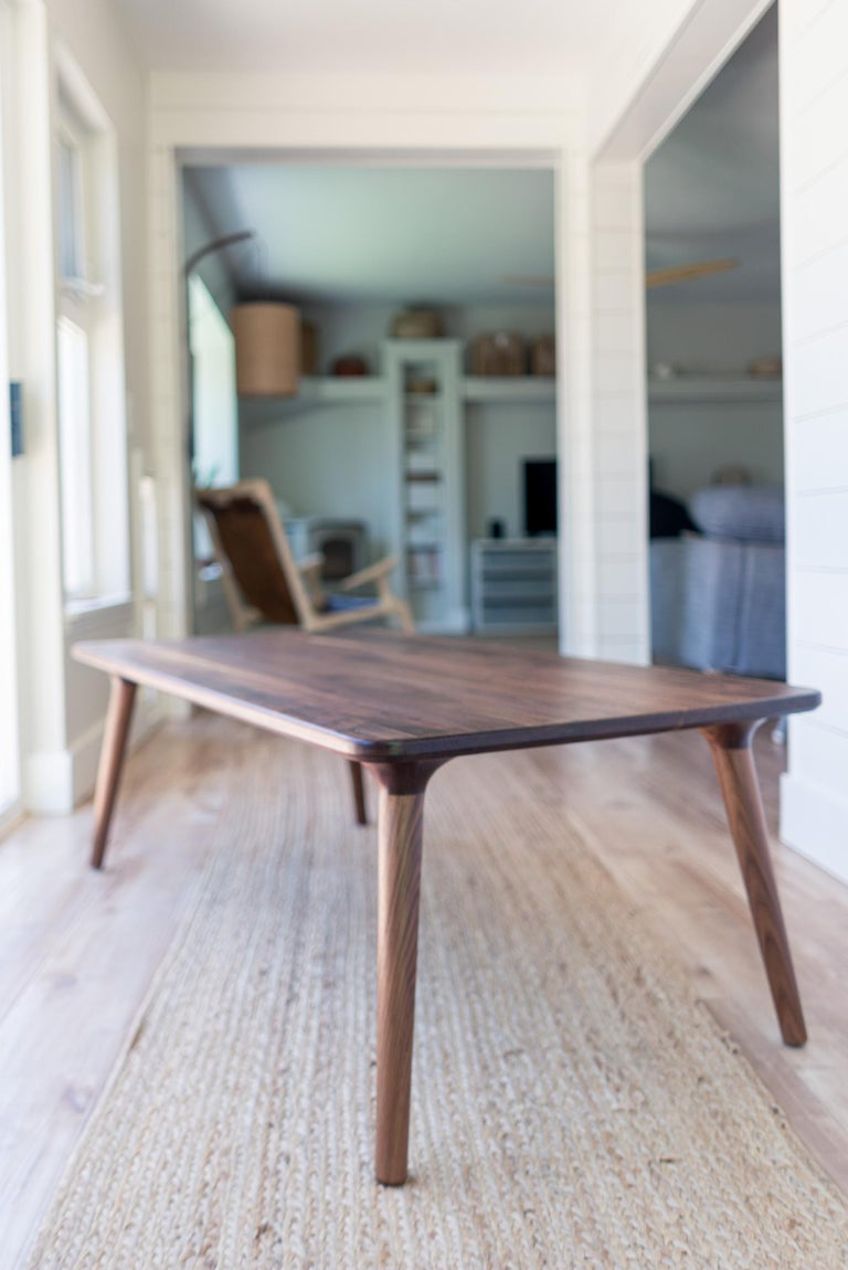A beautiful, minimal coffee or cocktail table for your home in the Mid-Century Modern or Danish style, with hints of Scandinavian. Handmade from American Walnut. The legs give this piece a light, airy feel, while strong joinery keeps it stabile and