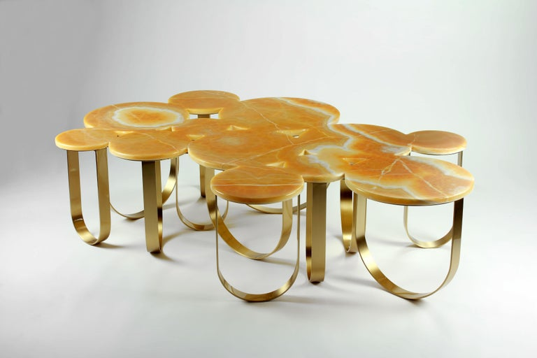 The 'Cloud' is a spectacular coffee table with structure in mirror polished brass and top in orange onyx. The brushed finishing of the brass creates interesting reflections of light. The artwork is hand signed and numbered by the artists (engraved).