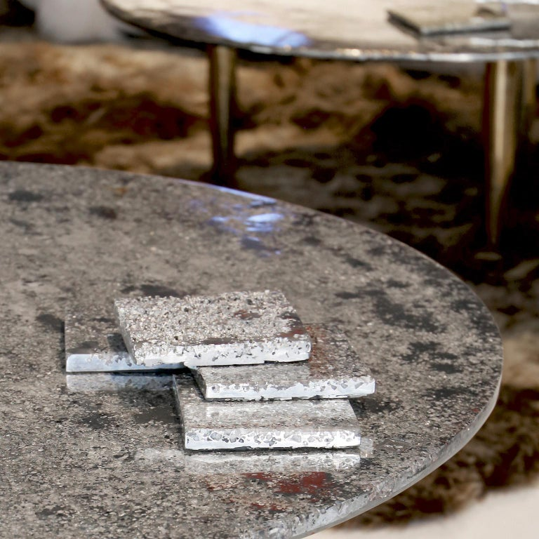 In stock: This contemporary coffee table is a unique piece, created by Xavier Lavergne and made of melted pewter with coral design, embedded in resin and polished like a marble. The table is handmade in France. Each piece is unique and sold with its