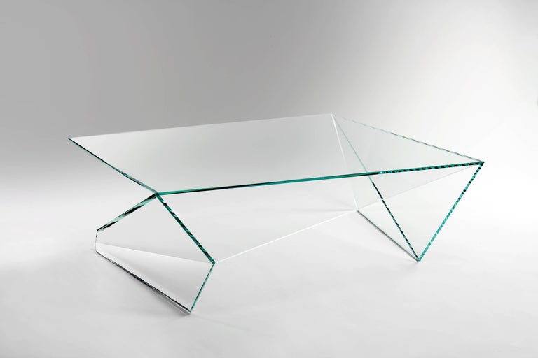 The executive desk 'Origami' is made of crystal glass. Coffee table dimensions: L120 W120 H37cm. The inspiration for origami came from the observation of a simple piece of paper which, being folded a few times according to an antique Japanese