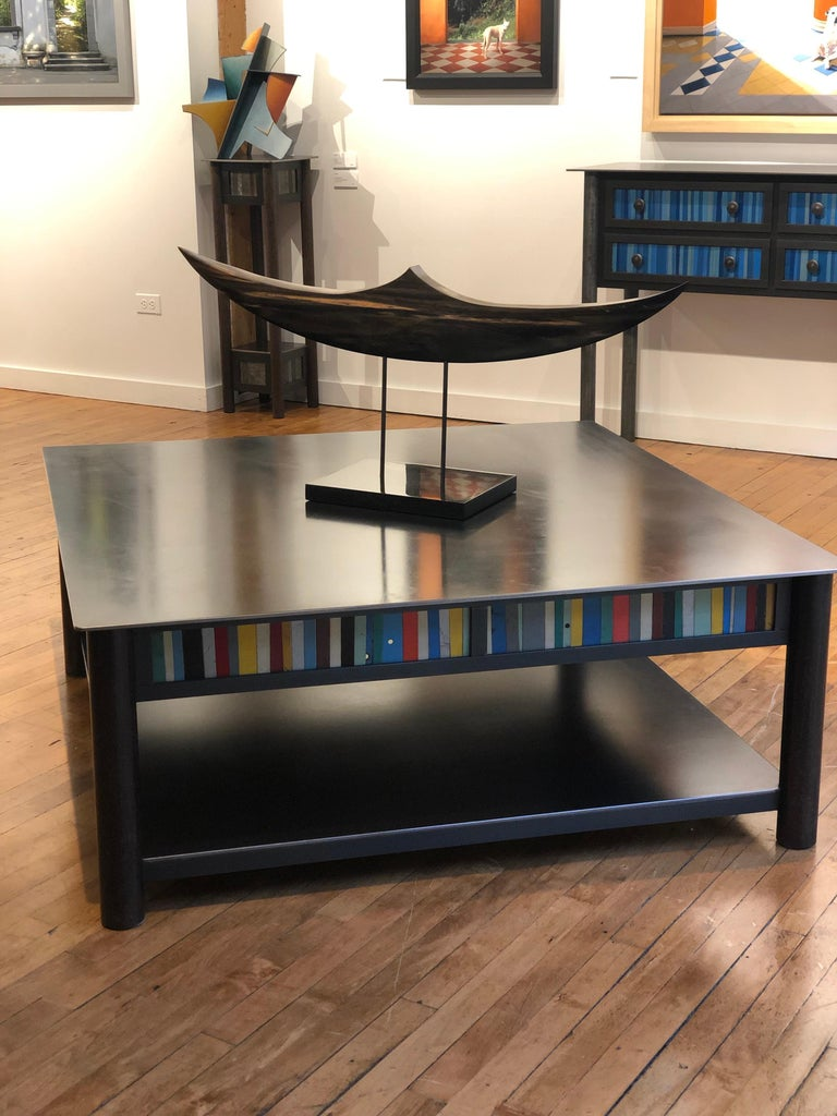This is a welded steel modern industrial coffee table with a low shelf and a quilted skirt of found metal strips arranged in a quilt pattern inspired by the quilts of Gee's Bend Alabama. Each piece of furniture is unique and made by Jim Rose. The