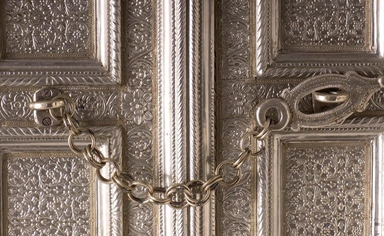 Shown in embossed Coffre pattern on white metal.