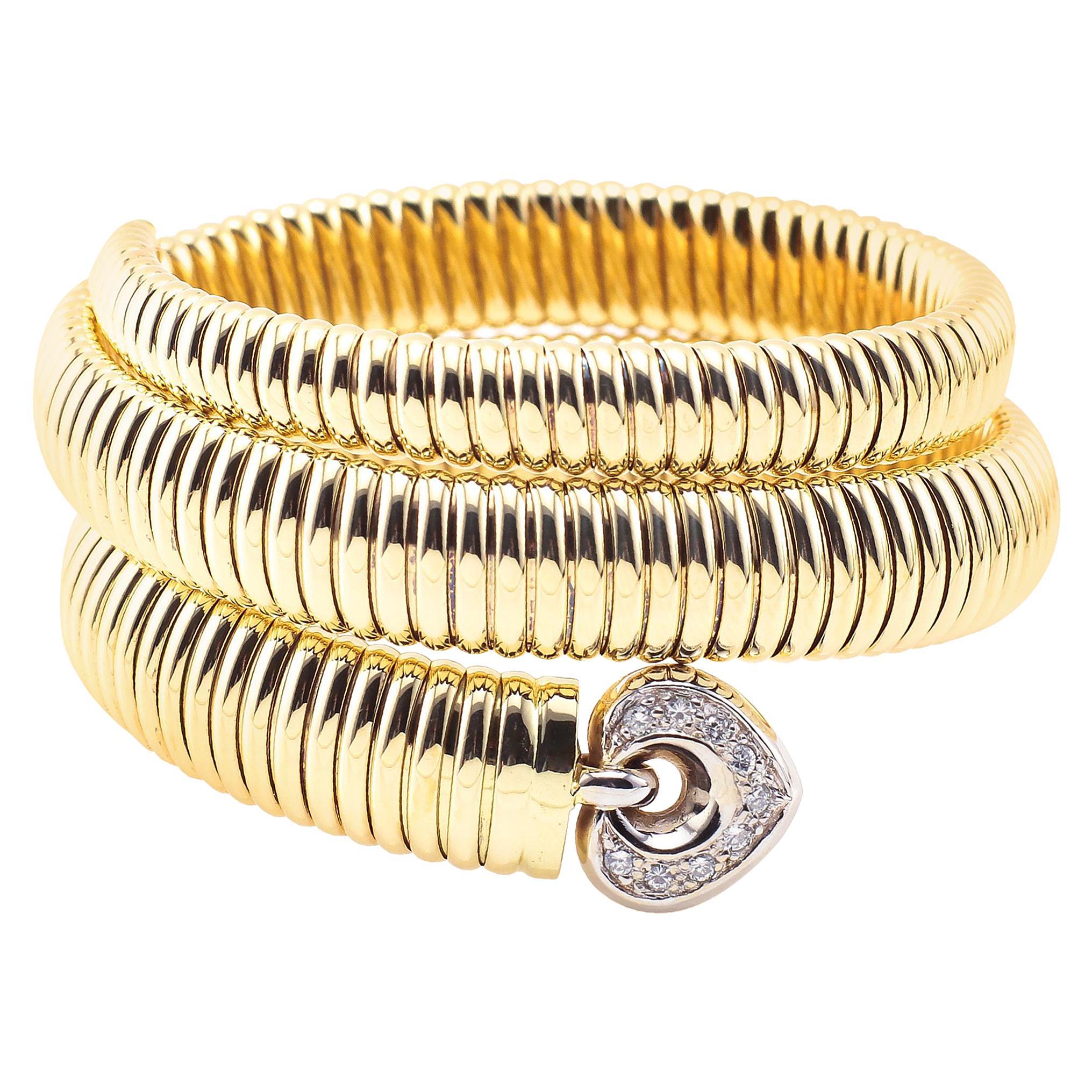 Coiled Snake 14 Karat Yellow Gold Bracelet with Diamonds