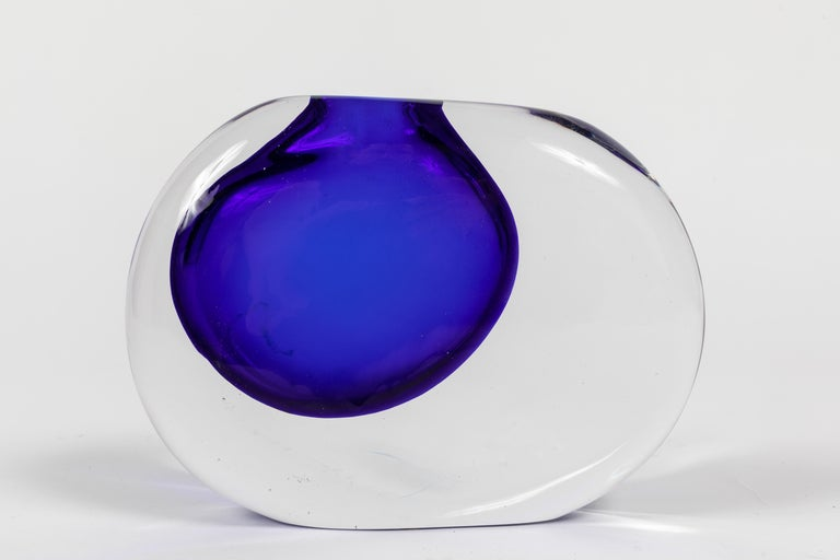A striking example of the Sasso this one in clear glass with a dramatic infusion of Cobalt blue. Designed by Antonio da Ros and made by the Murano glass house Cenedese.