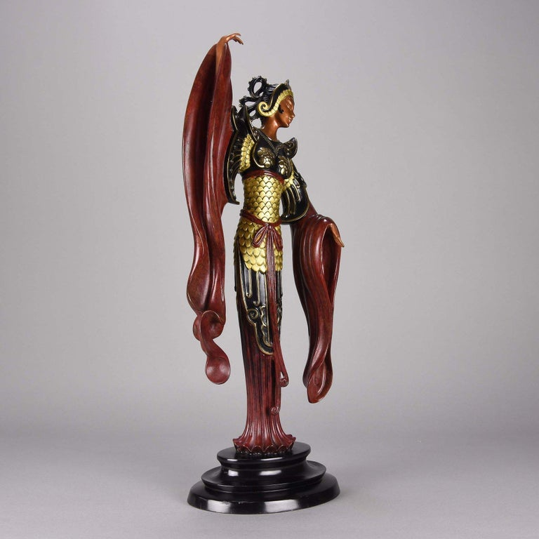 An eye-catching limited edition cold painted Art Deco bronze figure of an elegant beauty in a full length costume resembling a Fenghuang. The bronze surface with excellent color and detail, signed Erté, numbered 50/500, dated 1988 and with foundry