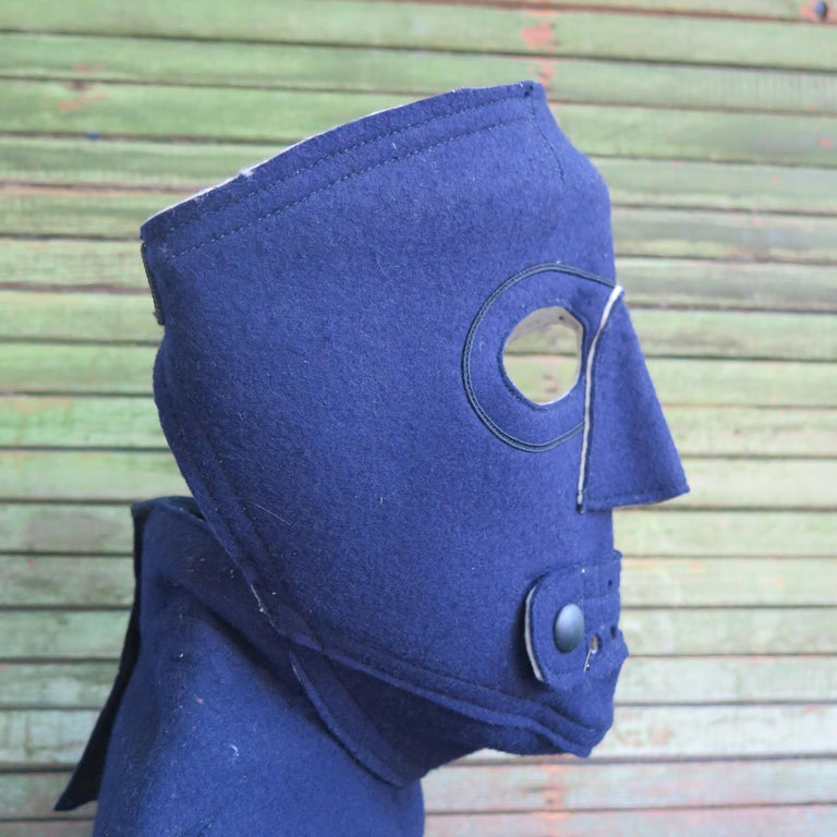 Mask made for face protection from cold at higher altitudes. A similar mask was loaned to the Museum of Modern Art for exhibition Modern Masks and Helmets some years ago. This type of felt mask was designed and made for the Navy with flap opening