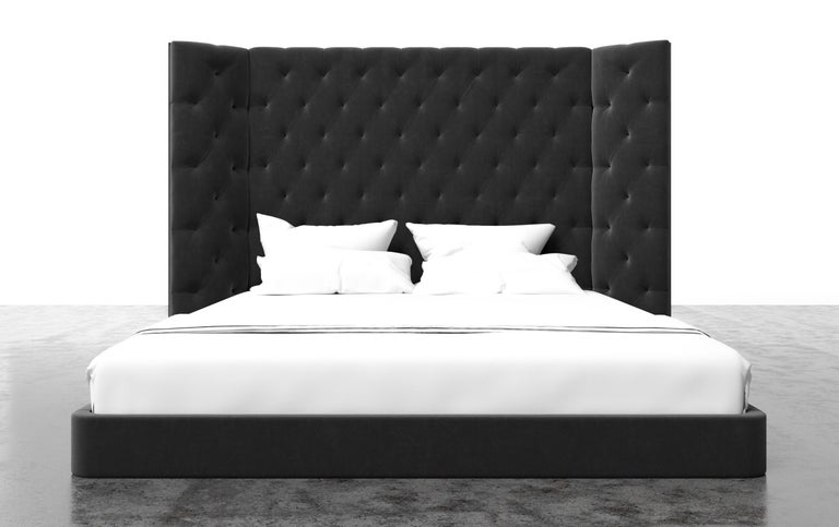 The Colette bed features a modern tufted upholstered headboard on a modern platform with winged arm details. Available in King, Cali King, Queen or Twin sizes. Fully custom and made to order in California. As shown in Queen size in Luxury