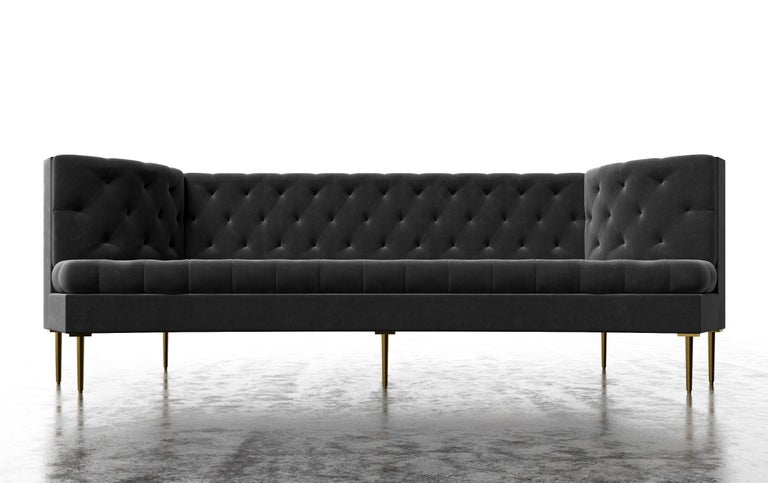 The Colette Sofa features a modern tufted tightly upholstered frame with dramatic curved arm details. Fully custom and made to order in California. As shown in Luxury Velvet/Charcoal $19,050.00. Starting at $17,250.00.