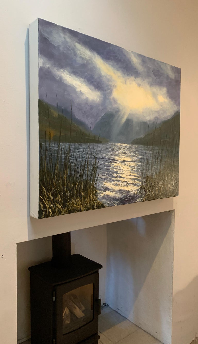 This oil painting is a vivid interpretation of dramatic light reflecting on Lake Buttermere in the Lake District, by British En Plein Air Artist Colin Halliday. He captures the shimmering reflections beautifully by a controlled use of texture,