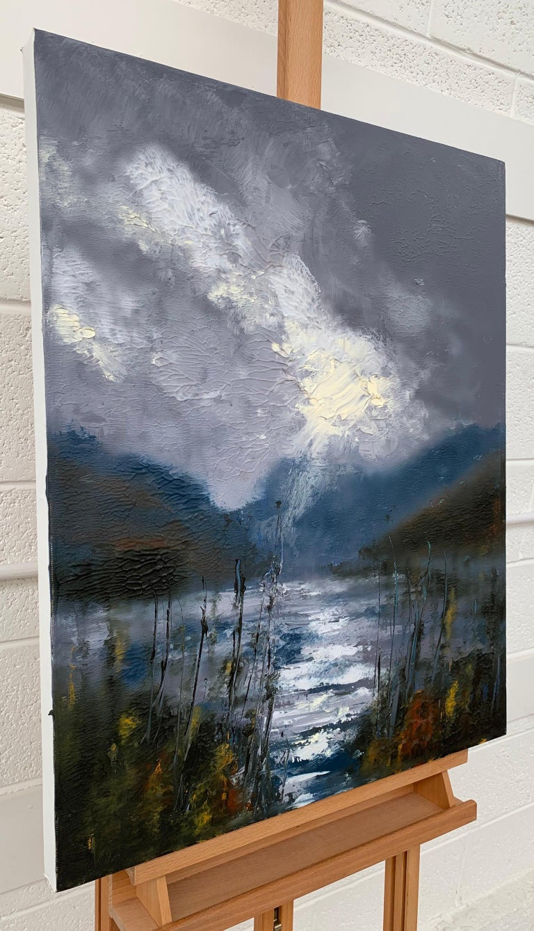 This oil painting is a vivid interpretation of dramatic storm on Lake Buttermere in the Lake District, by British Artist Colin Halliday. Surrounded by the mountains in the distance, this painting captures a passing storm in one of the most