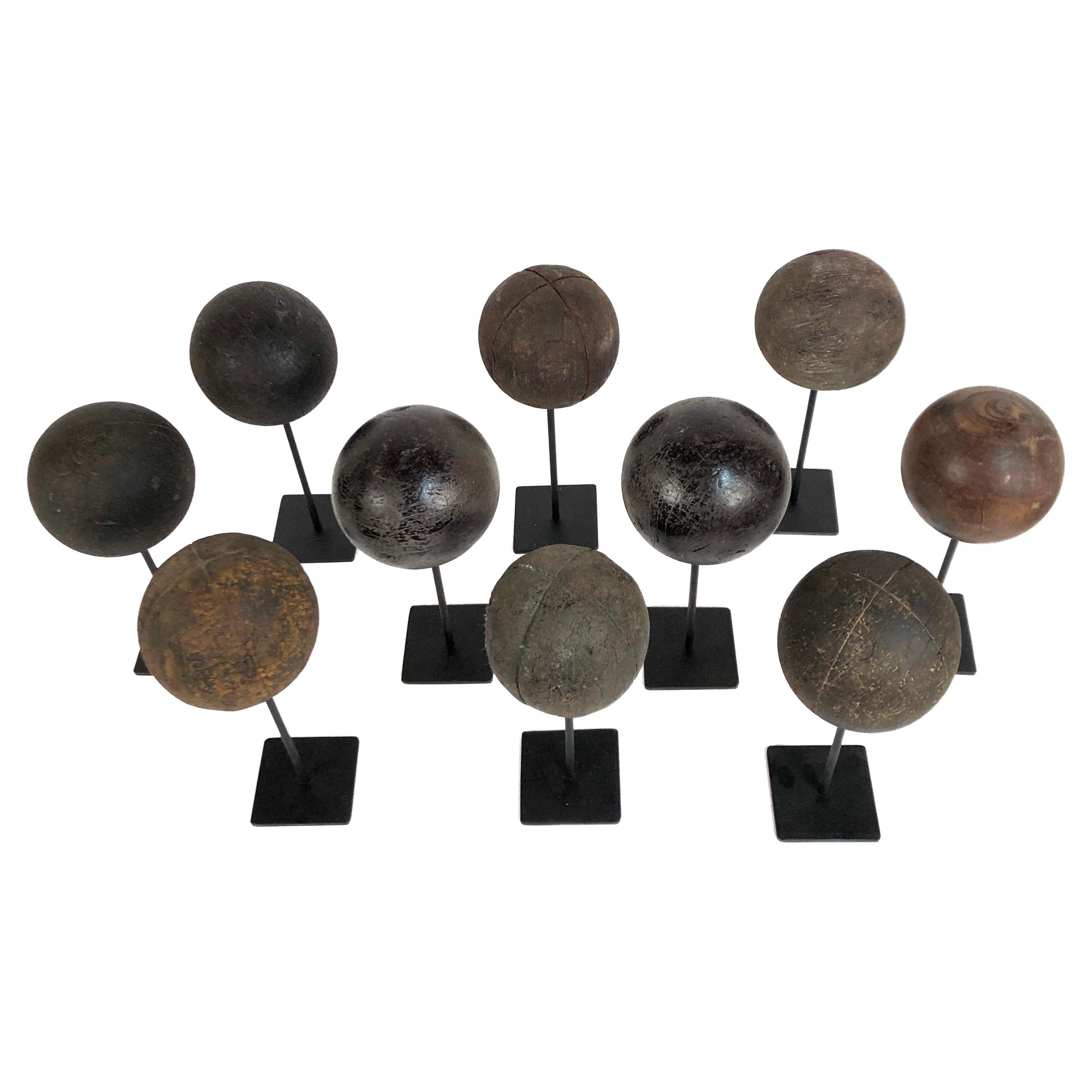 Collection of 10 Antique Wooden Bocce Balls on Custom Made Steel Stands
