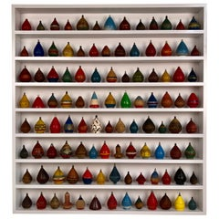 Collection of 100 Antique Spinning Tops in a Custom Shadow Box Frame