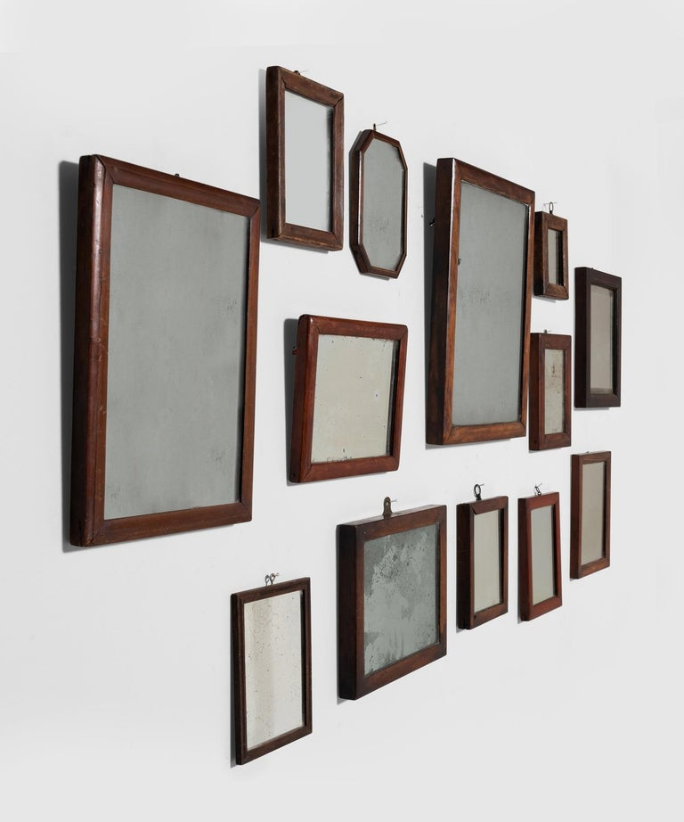 Unique wooden frames in various shapes and sizes, with original mercury glass plates.   Measures: 6.25