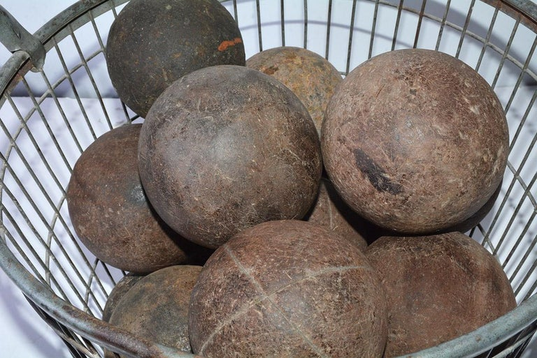 """Primitive antique handmade collection of 15 Italian bocce balls or French """"boules"""" of various sizes. The Italians call these balls bocce balls and the French """"boules"""" or """"boules de Pétanque"""". The game of bocce or boules are very similar. These solid"""