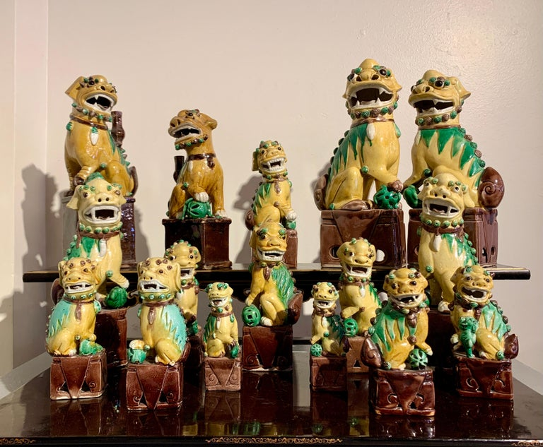 Chinese Export Collection of 16 Chinese Yellow Glazed Foo Dogs, Early 20th Century, China For Sale
