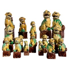 Collection of 16 Chinese Yellow Glazed Foo Dogs, Early 20th Century, China