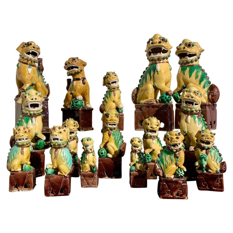 Collection of 16 Chinese Yellow Glazed Foo Dogs, Early 20th Century, China For Sale