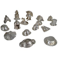 Collection of 16 Hats in Silvered Bronze