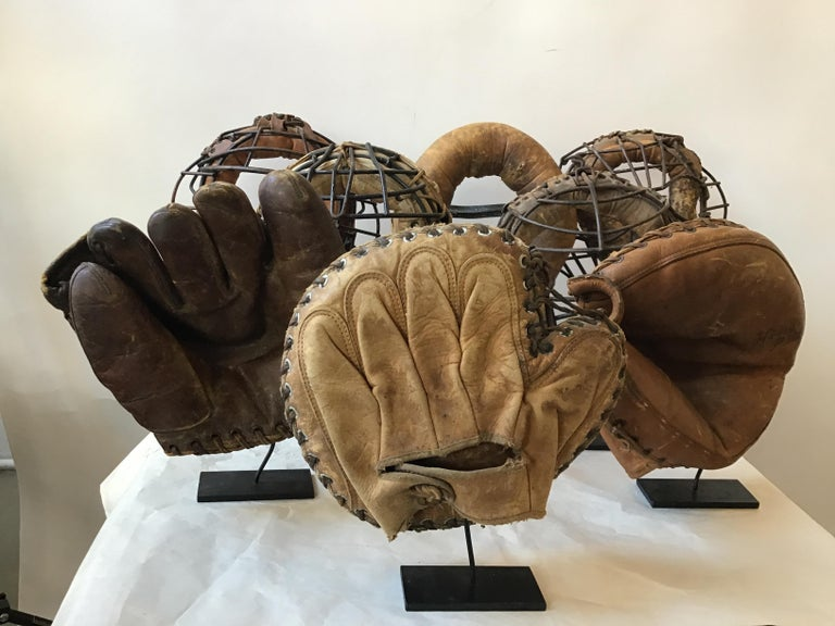 Collection of 8 1940s baseball gloves and catchers masks. Custom iron stands made for each one. Out of a EastHampton, NY estate.