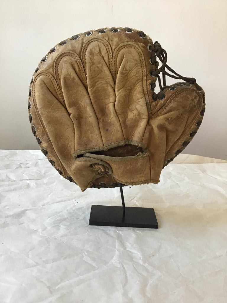 Iron Collection Of 8  Baseball Gloves And Catchers Masks From The 1940s For Sale