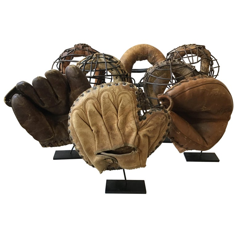 Collection Of 8  Baseball Gloves And Catchers Masks From The 1940s For Sale