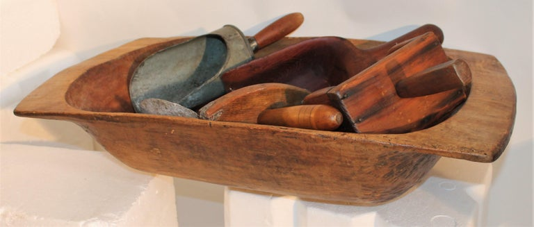 This fine country store collection of wood scoops and dough bowl are all in good condition.